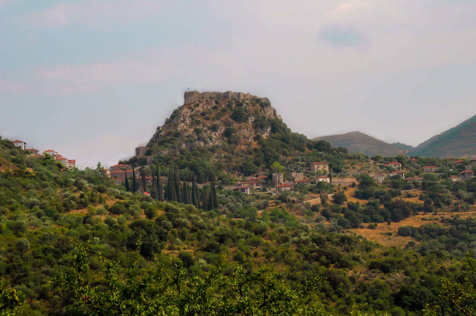 The Greek village of Karytaina as it appears high on a rock while driving in Arcadia.